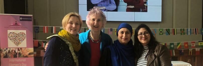 Four women at an event