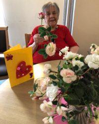 older woman flower arranging